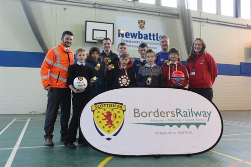 Craig Bowman , Network Rail Communications Manager (L), Presents The Winning Team From Newbattle High School With Their Medals And Shield